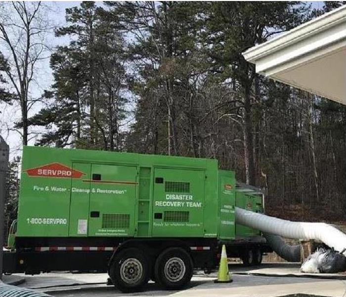 SERVPRO's Large green desiccant unit assisting in drying a commercial property
