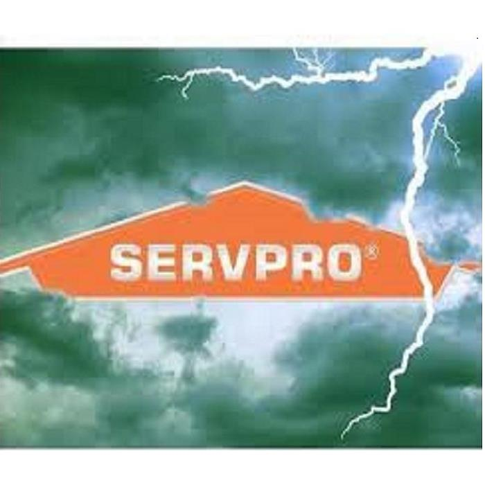 SERVPRO logo with dark clouds and lightning in the background